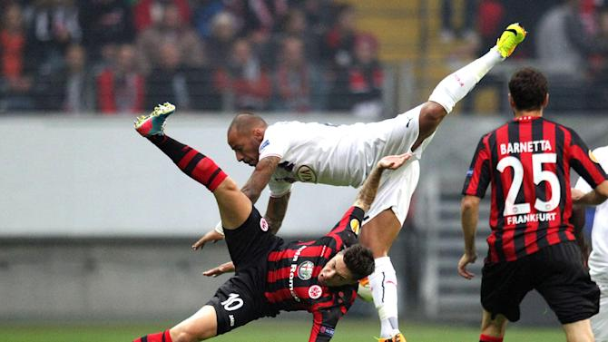 Frankfurt's Vaclav Kadlec of Czech Republic, bottom, and Bordeaux's Julien Faubert challenge for the ball during a Europa League Group F match between Eintracht Frankfurt and FC Girondins Bordeaux in Frankfurt, Germany, Thursday, Sept.19, 2013