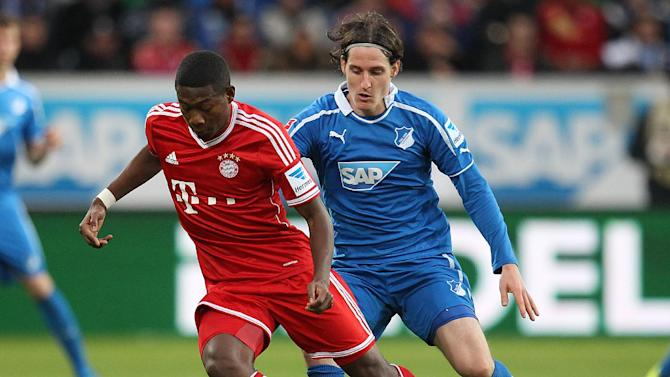 Hoffenheim's Sebastian Rudy, right, and Bayern's David Alaba of Austria challenge for the ball during a German first division Bundesliga soccer match between TSG 1899 Hoffenheim and Bayern Munich in Sinsheim, Germany, Saturday, Nov.2, 2013