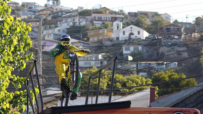 A competitor rides his bike during the Valparaiso Cerro Abajo urban downhill mountain bike race in Valparaiso city