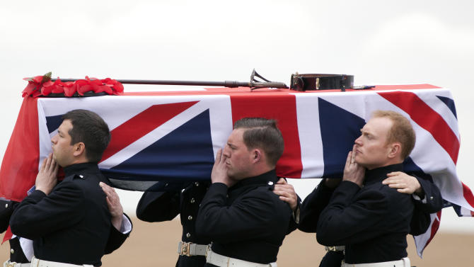 The casket of  World War One soldier Lieutenant John Harold Pritchard is carried during a ceremony at the H.A.C. cemetery in Ecoust-St-Mein, France on Tuesday, April 23, 2013. Almost 100 years after they were killed in action, Lieutenant John Harold Pritchard and Private Christopher Douglas Elphick were re-interred with full military honors in a private ceremony. . Lieutenant Pritchard was killed in action on May 15, 1917 during an enemy attack near Bullecourt, France and his remains were found in a field near the site in 2009. His body was eventually identified by a silver bracelet with his name engraved on it. (AP Photo/Virginia Mayo)
