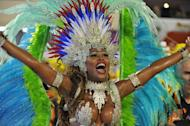 A reveler of the Inocentes de Belford-Roxo samba school performs during the first night of Carnival parade at the Sambadrome in Rio de Janeiro on February 10, 2013