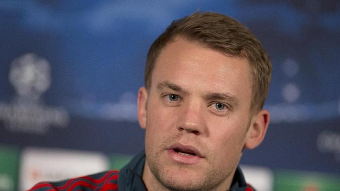 Bayern Munich's goalkeeper Manuel Neuer speaks during a press conference in London, Tuesday, Feb. 18, 2014, ahead of their round of 16 Champions League soccer match against Arsenal on Wednesday