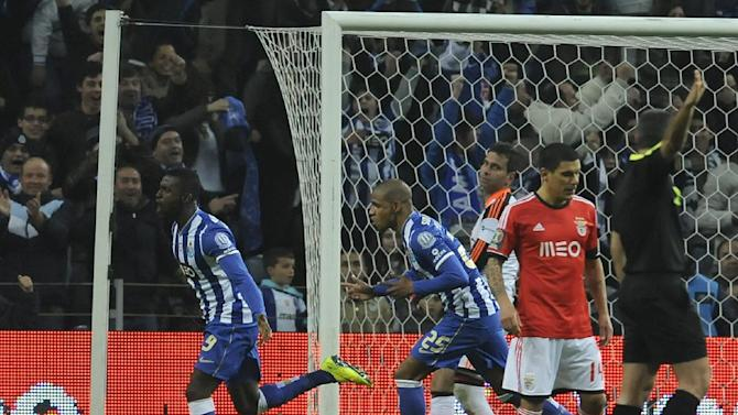 FC Porto's Jackson Martinez, left, from Colombia celebrates with Fernando Reges from Brazil after scoring past Benfica's goalkeeper Artur Moraes, back, from Brazil in a Portugal Cup semifinal first leg soccer match at the Dragao stadium in Porto, Portugal, Wednesday, March 26, 2014