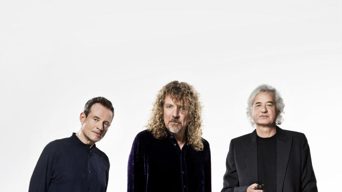 "This undated handout photo provided by the Warner Music Group shows members of Led Zepplin, from left, John Paul Jones, Robert Plant and Jimmy Page. Led Zeppelin is coming to a movie theater near you. Then a record store. The iconic British rock 'n' roll band will release its 2007 ""Celebration Day"" reunion as a concert film on Oct. 13, then will put out the show on multiple video and audio formats on Nov. 19. (AP Photo/Warner Music Group, Soren Solkaer Starbird)"