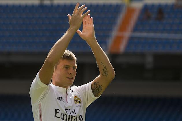 German international soccer player Toni Kroos, salutes supporters, during his official presentation at the Santiago Bernabeu stadium in Madrid, Spain, Thursday, July 17, 2014, after signing for Real M