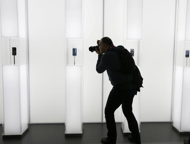A photographer takes a picture of the new Samsung Galaxy S6 smartphone during the Mobile World Congress in Barcelona