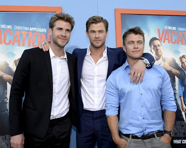 """Cast member Chris Hemsworth (C) poses with his brothers actors Liam Hemsworth (L) and Luke Hemsworth during the premiere of the film """"Vacation"""" at the Regency Village Theatre in the Westwood"""