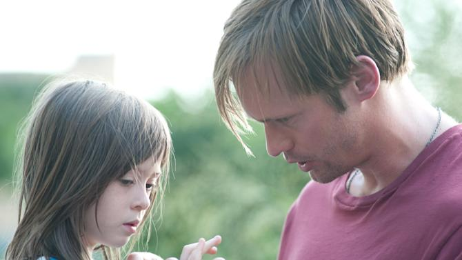 """This film image released by Millennium Entertainment shows Onata Aprile, left, and Alexander Skarsgard in a scene from """"What Maisie Knew.""""  (AP Photo/Millennium Entertainment, JoJo Whilden)"""
