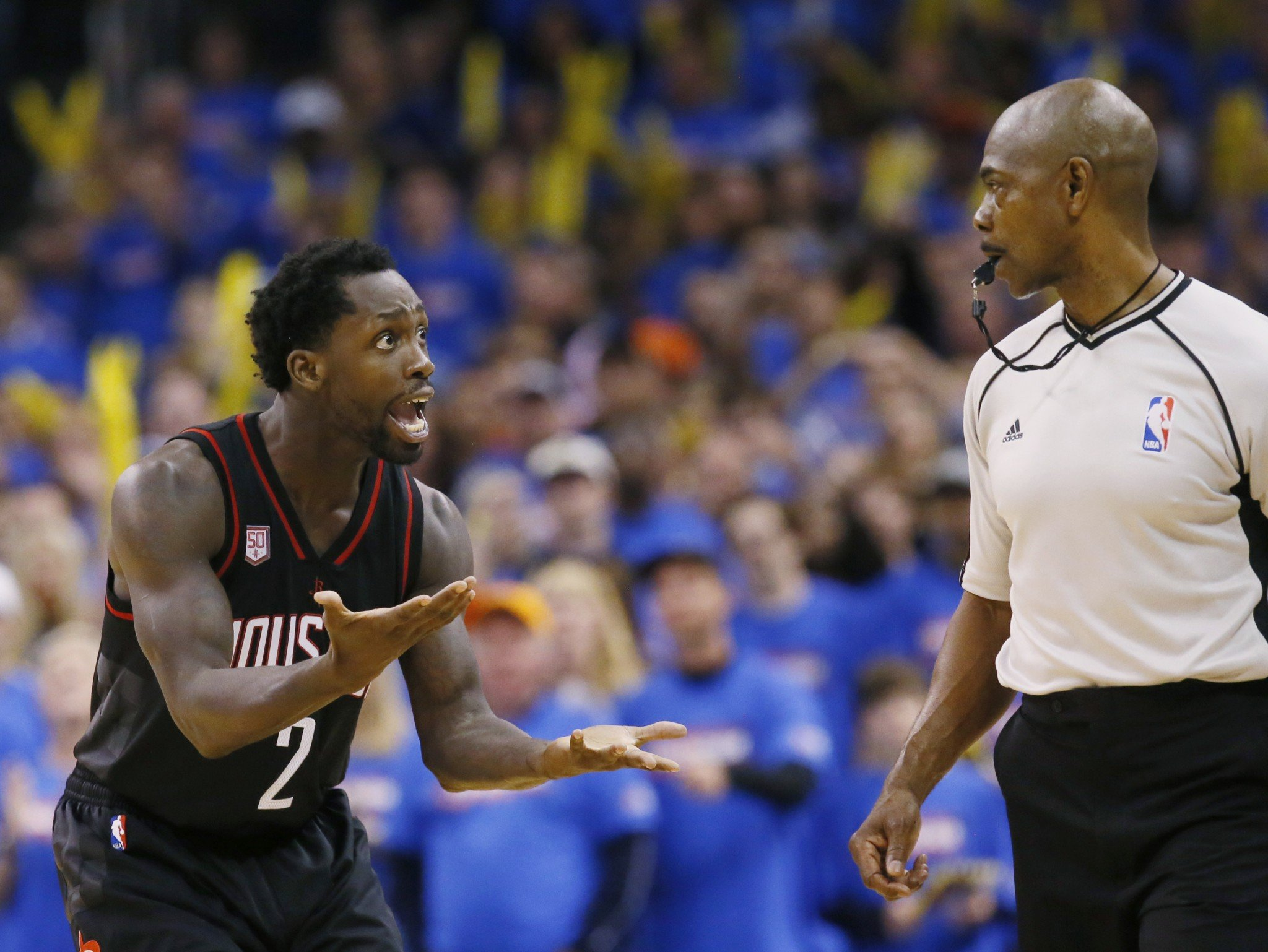 Rockets guard Patrick Beverley discusses a call with official Tom Washington during Game 3 against the Thunder on Friday. (AP)