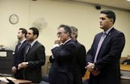 From left to right, attorney Adam Rosengard, representing Dean Smith; attorney Thomas Mirigliano, representing Kimberly Arendt; defense attorney James Lisa, representing John Cramsey; and Hudson County Assistant Prosecutor Thomas Zuppa appear before Hudson County Superior Court Judge Mitzy Galis-Menendez during the Holland Tunnel weapons case in Jersey City, N.J. (Ed Murray/NJ Advance Media via AP, Pool)