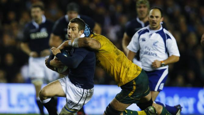 Australia's Horwill tackles Scotland's Laidlaw during their rugby union international test match in Edinburgh