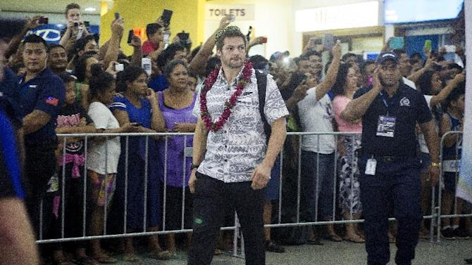 The New Zealand All Blacks rugby union player Richie McCaw, center, arrives in Apia, Samoa, Monday, July 6, 2015. New Zealand and Samoa will play in a rugby test match on Wednesday. (Dean Purcell/New Zealand Herald via AP) NEW ZEALAND OUT, AUSTRALIA OUT
