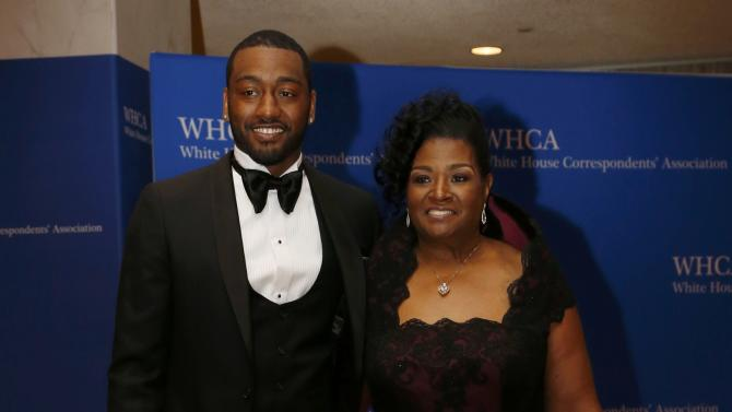 NBA basketball player John Wall and guest arrive on the red carpet for the annual White House Correspondents Association Dinner in Washington