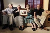 From left, Patrick Boyle, Linda Boyle, Lyn Coleman and Jim Coleman hold photo of their kidnapped children, Joshua Boyle and Caitlan Coleman, who were taken by the Taliban in late 2012, Wednesday, June 4, 2014, in Stewartstown, Pa. The family of a pregnant American woman who went missing in Afghanistan in late 2012 with her Canadian husband received two videos last year in which the couple asked the U.S. government to help free them and their child from Taliban captors, The Associated Press has learned. (AP Photo/Bill Gorman)