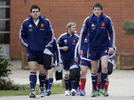 France's rugby team players Guirado and Trinh-Duc arrive to attend a training session at the Rugby Union National Centre in Marcoussis