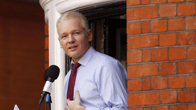 FILE - This Aug. 19, 2012 file photo shows WikiLeaks founder Julian Assange making a statement to the media and supporters at a window of Ecuadorian Embassy in central London. Lawyers for Assange argue before the U.S. military's highest court for public access to legal documents in the court-martial of Pfc. Bradley Manning, the soldier charged with aiding the enemy for allegedly giving hundreds of thousands of classified U.S. documents to Assange's secret-busting website WikiLeaks.  (AP Photo/Sang Tan, File)