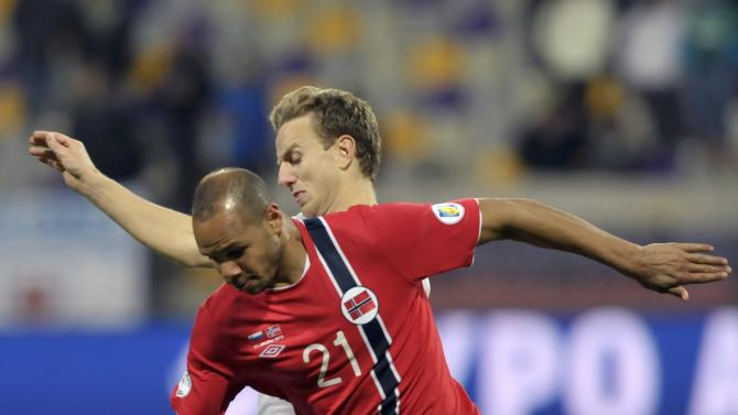 Norway's Braaten is challenged by Slovenia's Mertelj during their World Cup 2014 qualifier soccer match in Maribor