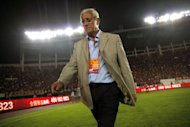 World Cup-winning Italian coach Marcello Lippi leaves the pitch on May 20. Lippi, one of the world's most successful managers, is facing one of his trickiest tests in the trigger-happy Chinese Super League (CSL) with his new club, Guangzhou Evergrande