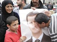 "A Syrian kisses the portrait of President Bashar al-Assad during a rally to show their support in the capital Damascus on April 30. The Syrian authorities have set a deadline of 15 days for people who had committed ""unlawful acts"" to give themselves up, as a wave of arrests was reported across the country"