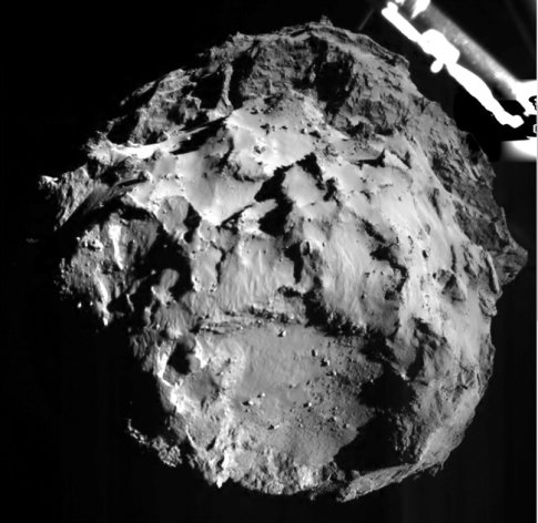 The picture released by the European Space Agency ESA on Wednesday, Nov. 12, 2014 was taken by the ROLIS instrument on Rosetta's Philae lander during descent from a distance of approximately 3 km from the 4-kilometer-wide (2.5-mile-wide) 67P/Churyumov-Gerasimenko comet. Hundreds of millions of miles from Earth, the European spacecraft made history Wednesday by successfully landing on the icy, dusty surface of a speeding comet. (AP Photo/ESA)