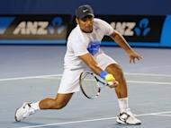 Leander Paes hits a volley during the men's doubles final at the 2012 Australian Open in Melbourne, Australia, on January 28. Paes - India's top tennis doubles player - will team up with a poorly-rated and inexperienced partner at the Olympics after two higher-ranked players refused to play with him, officials said Thursday