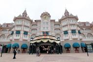 The entrance of the Disneyland park in Chessy, outside Paris, in March 2012. The sprawling park, served by high-speed trains and home to 57 attractions, boasts Big Thunder Mountain and Space Mountain Mission 2, but also lies beneath a debt mountain that amounted to 1.87 billion euros last year