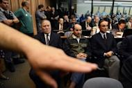 Julio Poch (R), a Dutch national and a former Argentine naval aviator extradited from Spain in May 2010, attends trial as defendant, in Buenos Aires. A trial involving 800 cases of human rights abuses during Argentina's 1976-1983 military junta opened on Wednesday, chronicling the use of torture and murder during the dictatorship.