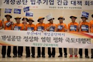 South Korean businessmen involved in the joint-venture Kaesong industrial park in North Korea call for the 'normalisation' of relations after Pyongyang denied them access to the zone, in Seoul on July 3, 2013. Dozens of South Korean firms on Wednesday threatened to withdraw from Kaesong.
