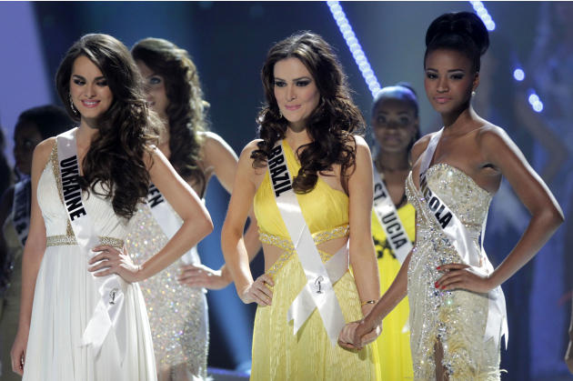 The top three finalists at the Miss Universe pageant, Miss Ukraine Olesia Stefanko, left, Miss Brazil Priscila Machado, center, and Miss Angola Leila Lopes wait for the final announcements during the