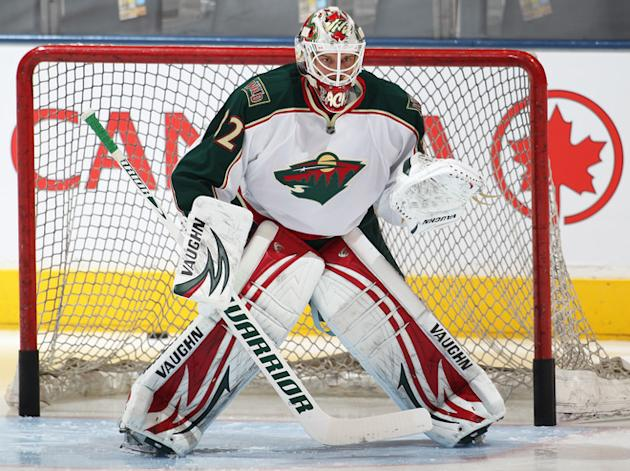 Niklas Backstrom #32 Of The Minnesota Wild Stops Getty Images