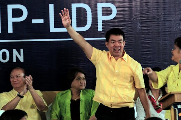 Senator Aquilino 'Koko' Pimentel III waves to supporters during the the administration coalition's senatorial slate proclamation at Club Filipino in Greenhills, San Juan City Oct. 1. Pimentel was among the first to file a certificate of candidacy at the Commission on Elections in Intramuros. (Joseph Vidal, NPPA Images)