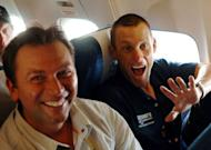 US Lance Armstrong (R) and his team director Johan Bruyneel, pictured after the ninth stage of the 92nd Tour de France cycling race between Gerardmer and Mulhouse, in 2005. Tour de France organizers admitted that they were against re-attributing Armstrong's seven wins as the sport's doping crisis claimed a new victim, Bruyneel, one of the disgraced American's closest allies