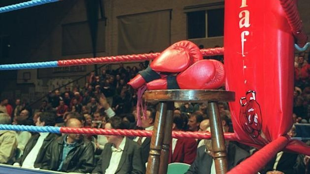 Generic shot of boxing ring, gloves and stool (PA Photos)