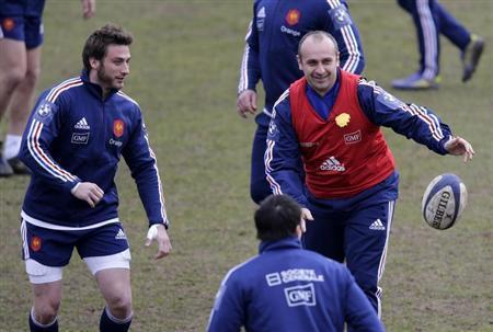 France's rugby player Medard and coach Saint-Andre attend a training session at the Rugby Union National Centre in Marcoussis