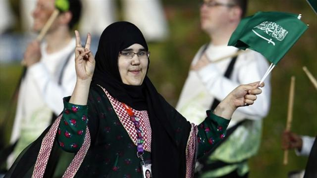 Olympic Games - Saudi's first woman bows out after symbolic show