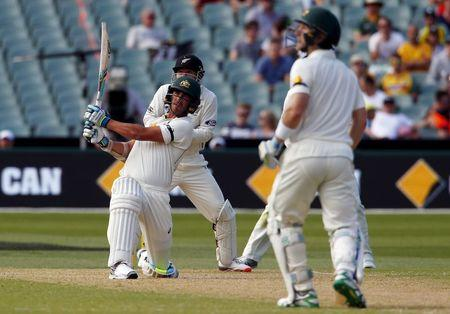 Australia's Peter Nevill watches as team mate Mitchell Starc, who is suffering an injury to his right foot, hits a six during the second day of the third cricket test match against New Zealand at