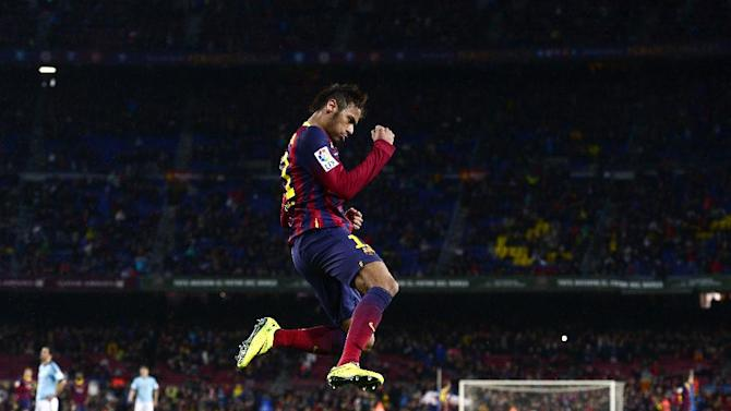 FC Barcelona's  Neymar, from Brazil, reacts after scoring against Celta Vigo during a Spanish La Liga soccer match at the Camp Nou stadium in Barcelona, Spain, Wednesday, March 26, 2014