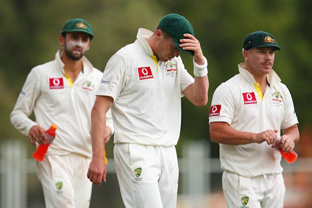 ADELAIDE, AUSTRALIA - NOVEMBER 26: Peter Siddle of Australia and team mates react at the conclusion of play on day five of the Second Test Match between Australia and South Africa at Adelaide Oval on