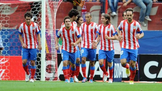 Atletico see off Valladolid, Malaga held