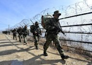 File photo shows South Korean marines walking along an iron fence on the tense border with North Korea. The South Korean and US military will soon sign a new plan to counter any North Korean attacks and hold regular exercises, Seoul said Wednesday, amid wariness over the North's power transition