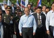 Myanmar president Thein Sein (centre) visits the Regional Investment and Economic Center in Chonburi. Thein Sein has made his first official trip to Thailand since taking power in a visit likely to focus on economic ties between his reforming nation and its more affluent neighbour