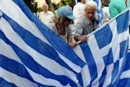 Supporters of Greek conservative party New Democracy distribute flags prior to a pre-election speech of their leader Antonis Samaras in Athens. Out of cash and shunned by disillusioned voters fed up with austerity, Greek parties are turning to social media to get their message across ahead of Sunday's national elections