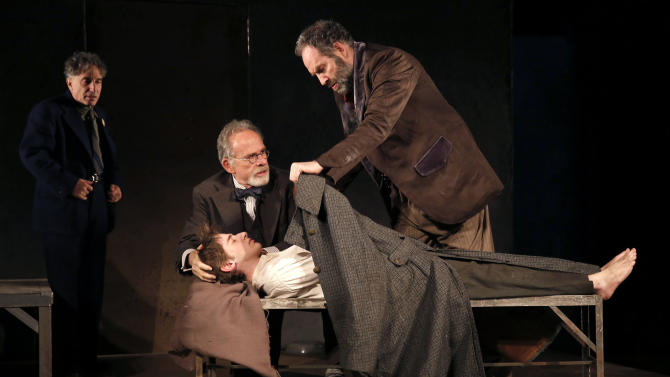 """This theater image released by The Public Theater shows, from left, Chip Zien, Ron Rifkin, Noah Robbins, and Daniel Oreskes in """"The Twenty-Seventh Man,"""" running at The Public Theater at Astor place through Dec. 9. (AP Photo/The Public Theater, Joan Marcus)"""