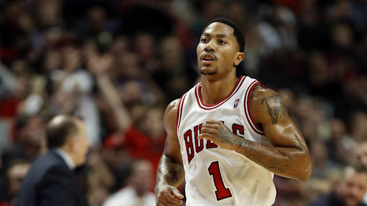 Chicago Bulls guard Derrick Rose runs up the court after scoring against Indiana Pacers during the second half of an NBA basketball game in Chicago, Saturday, Nov. 16, 2013. The Bulls won 110-94