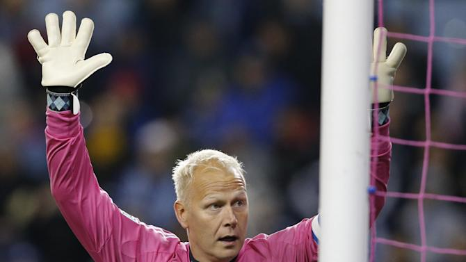 Sporting KC goalkeeper Jimmy Nielsen watches a shot sail past his goal and into the crowd during the first half of an MLS soccer match against D.C. United in Kansas City, Kan., Friday, Oct. 18, 2013