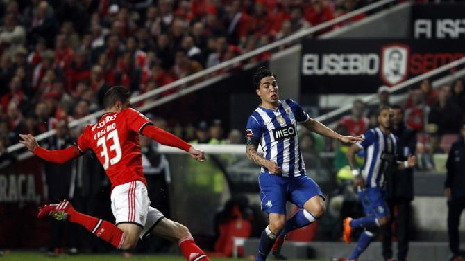 Benfica's Jardel Vieira fights for the ball with Porto's Josue Pesqueira during their Portuguese Premier League soccer match at Luz stadium