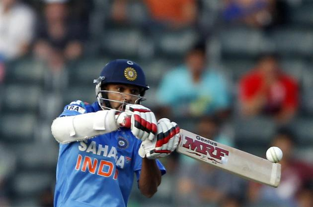 India's Shikhar Dhawan plays South Africa's Lonwabo Tsotsobe delivery during their first one-day international (ODI) in Johannesburg