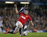 Chelsea's Brazilian midfielder Ramires (up) vies with Manchester United's English midfielder Nick Powell during the English League Cup Fourth Round football match between Chelsea and Manchester United at Stamford Bridge in London. Chelsea won 5-4 in extra time