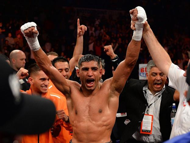 Amir Khan reacts to defeating Julio Diaz in Sheffield on April 27, 2013. Khan, the former light-welterweight world champion, won a unanimous -- but narrow -- points decision by scores of 114-113, 115-113 and 115-112 in an enthralling encounter
