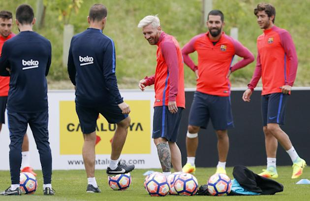 FC Barcelona's Lionel Messi with teammates during training